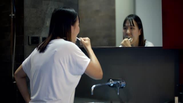 woman brushing teeth - toothpaste stock videos & royalty-free footage