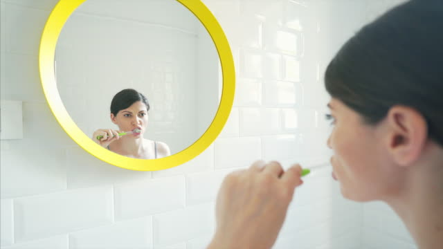 woman brushing teeth. - toothbrush stock videos and b-roll footage