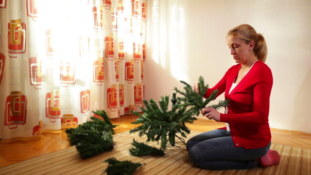 woman building christmas tree - ponytail stock videos and b-roll footage