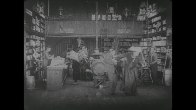 1917 woman bullies man in busy butcher shop - fatty arbuckle stock videos and b-roll footage