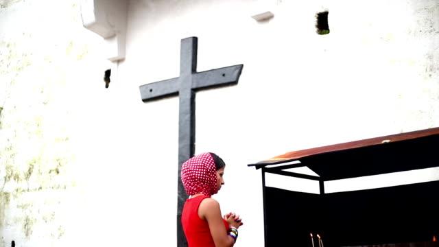 woman burning candlelight in panjim church, goa - church stock videos & royalty-free footage