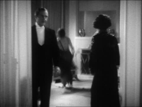 b/w 1936 woman butler talk / woman jumps on bed in background / feature - 1936 stock videos and b-roll footage