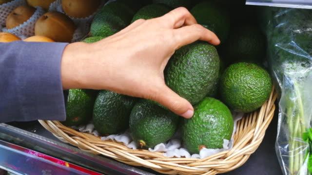 woman buy avocado shot on smart phone - organic stock videos & royalty-free footage
