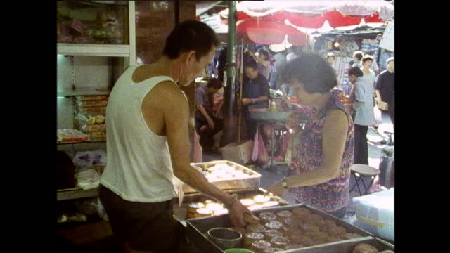 woman buy mooncakes from street food stall in hong kong - paper bag stock videos & royalty-free footage