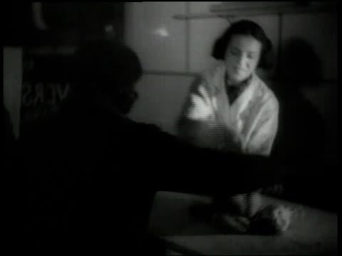 1938 ha woman buying a goose from shop / amsterdam, netherlands - ユダヤ教点の映像素材/bロール
