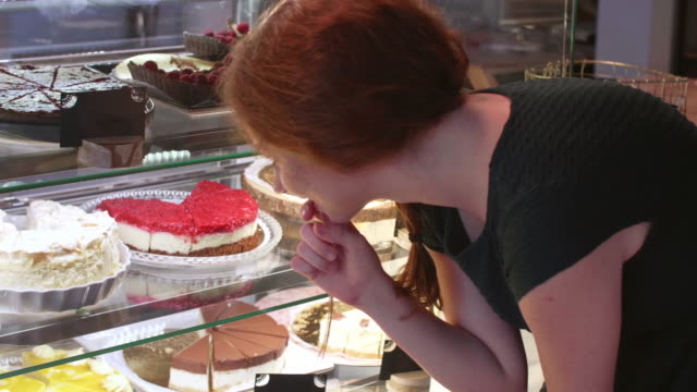 Woman buying cake at bakery/ Debica/ Poland