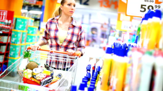 woman buying cosmetic products in supermarket. - cleaning agent stock videos & royalty-free footage