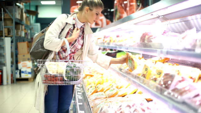 woman buying food in supermarket. - meat stock videos & royalty-free footage