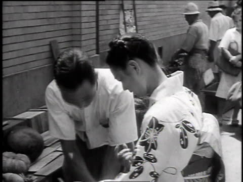 woman buying fruit on street / japan - 1947 stock videos & royalty-free footage