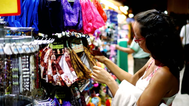 woman buying hair accessories - hair accessory stock videos and b-roll footage