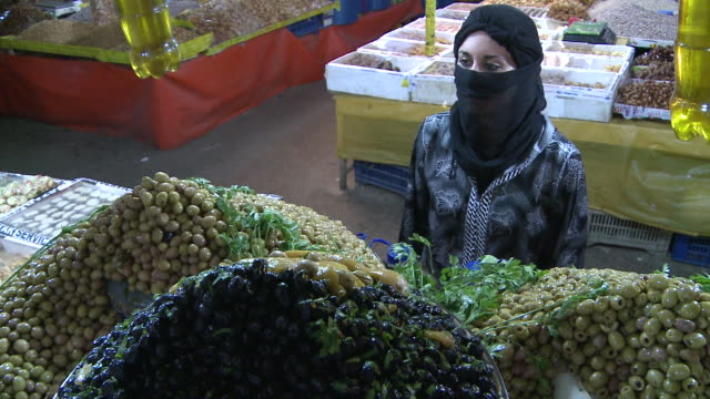 ms woman buying olives in market / taroudant, unspecified, morocco - exchanging stock videos & royalty-free footage
