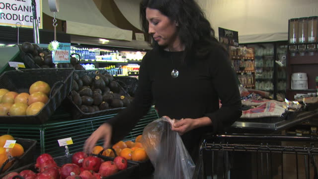 woman buying organic fruit - see other clips from this shoot 1172 stock videos & royalty-free footage