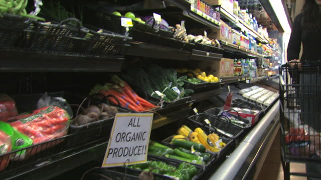 woman buying organic produce - see other clips from this shoot 1172 stock videos & royalty-free footage