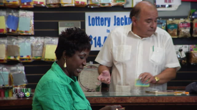 ms woman buying scratch off ticket from convenience store/ woman scratching ticket, losing, and buying another/ brooklyn, new york - rubble stock-videos und b-roll-filmmaterial