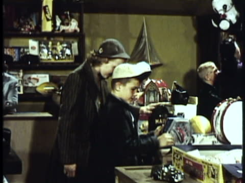 1953 montage cu tu ms woman buying toy for son in toy store then leaving / usa - toy store stock videos and b-roll footage