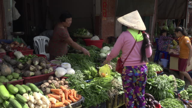 woman buying vegetables at street market - vendor stock videos & royalty-free footage