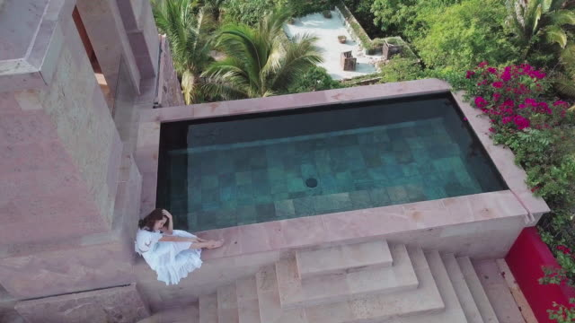 woman by a pool in paradise - standing water stock videos & royalty-free footage