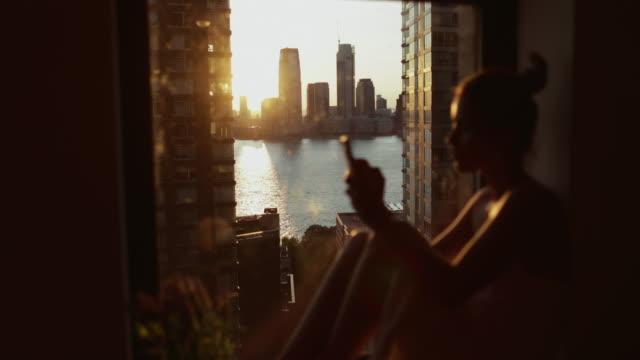 woman by the window in new york - silence stock videos & royalty-free footage