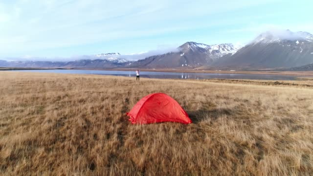 ws woman camping in remote mountain field,iceland - viewpoint stock videos & royalty-free footage