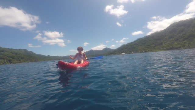 woman canoeing kayak - tahaa island stock videos & royalty-free footage