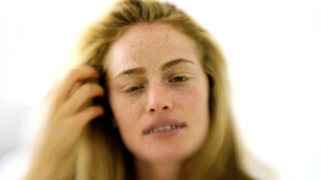 Woman caressing herface