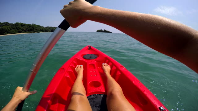 pov woman caribbean kayaking - aquatic sport stock videos & royalty-free footage