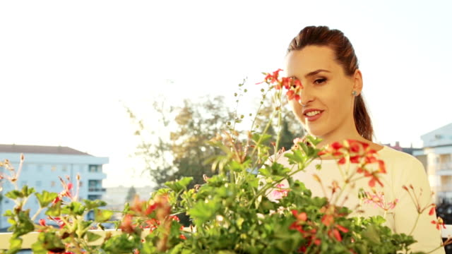 woman caring for flowers - balcony stock videos & royalty-free footage