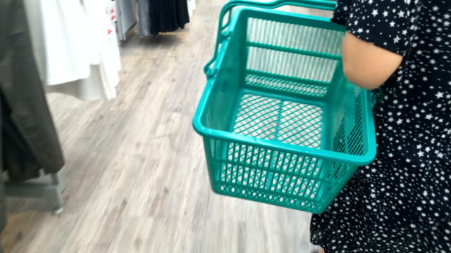 woman carring a basket - shopping basket stock videos and b-roll footage