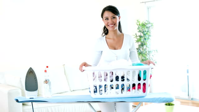 woman carrying a laundry basket to iron - laundry basket stock videos and b-roll footage