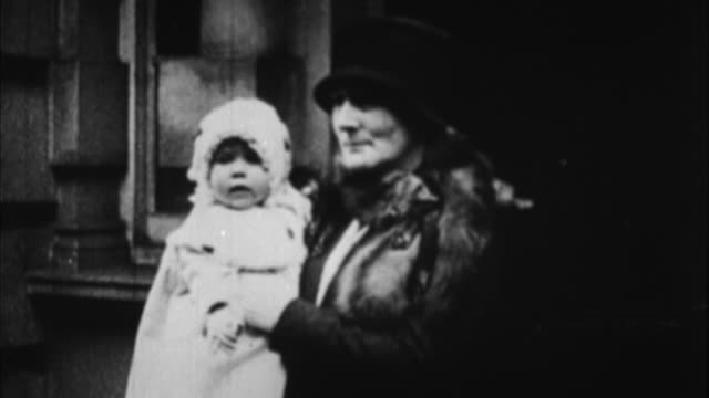 woman carrying baby queen elizabeth / london united kingdom - 1926 stock videos & royalty-free footage