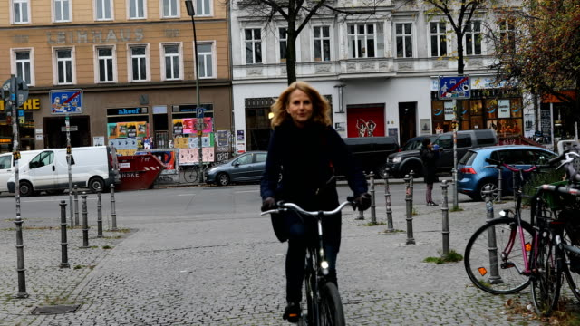 Woman carrying backpack while cycling in city