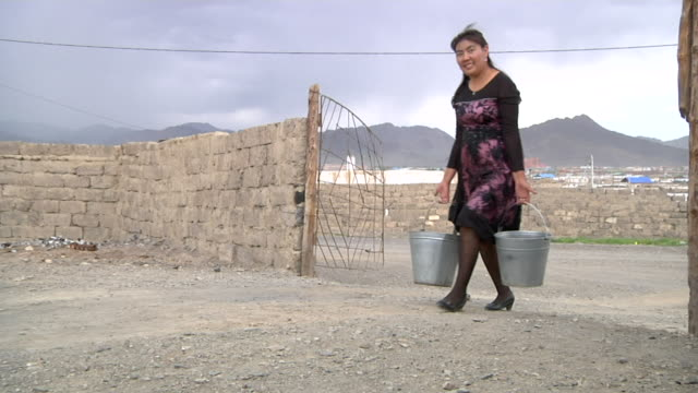 woman carrying buckets - kazakhstan stock videos and b-roll footage