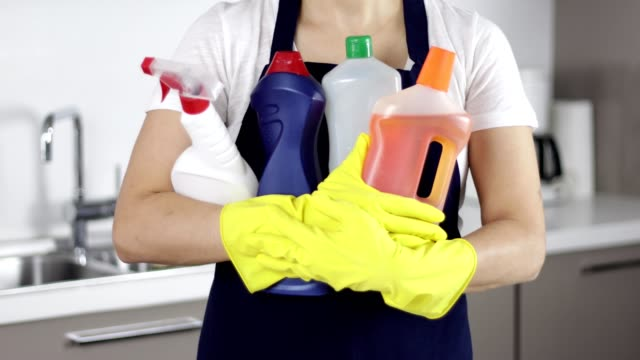 woman carrying cleaning supplies - spray cleaner stock videos & royalty-free footage