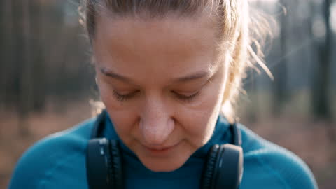 slo mo woman catching breath after jogging in the forest - catching stock videos & royalty-free footage
