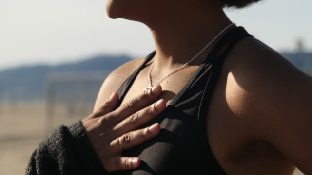 woman catching her breathe after workout - chest torso stock videos & royalty-free footage