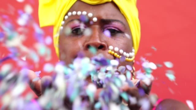 woman celebrating carnival with confetti - only mature women stock videos & royalty-free footage