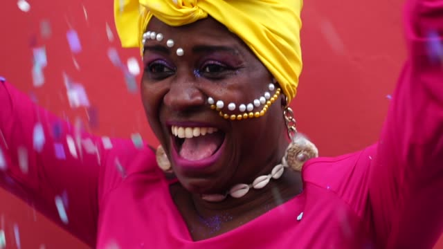 woman celebrating carnival with confetti - colombian ethnicity stock videos & royalty-free footage