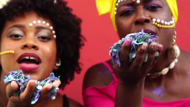 woman celebrating life with confetti - cultures stock videos & royalty-free footage