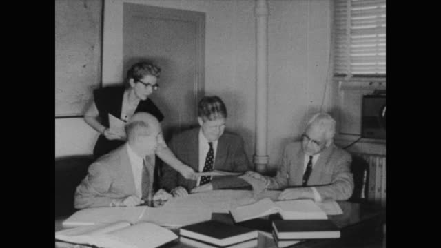 1960 woman census taker gives documents to three managers at the census bureau - census stock videos & royalty-free footage