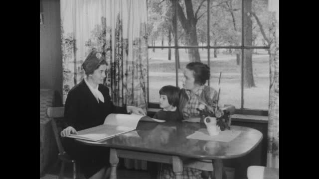 1960 woman census taker speaks with mother and little girl - census stock videos & royalty-free footage
