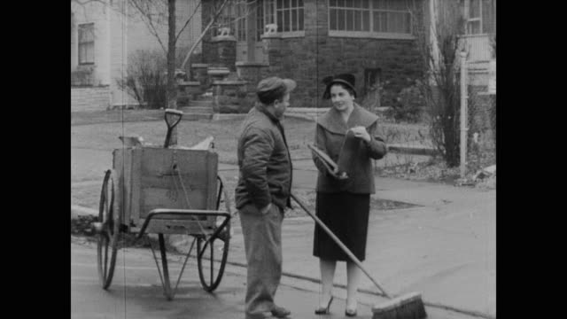 1960 woman census worker stops strangers to try and collect census data - census stock videos & royalty-free footage