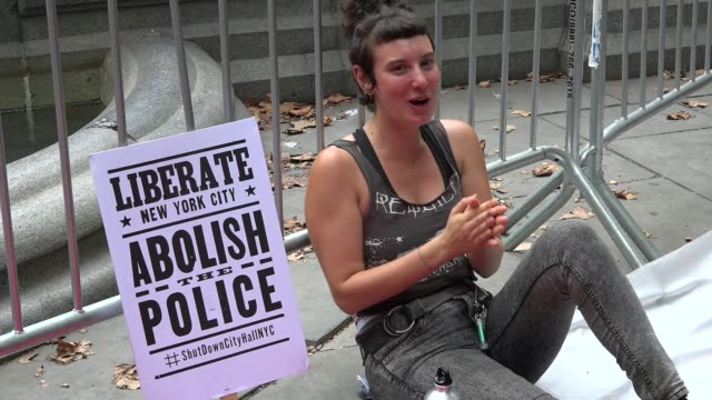 Woman chants No more donuts / Protesters occupied City Hall Park from Monday morning until the early hours of Tuesday August 02 /...