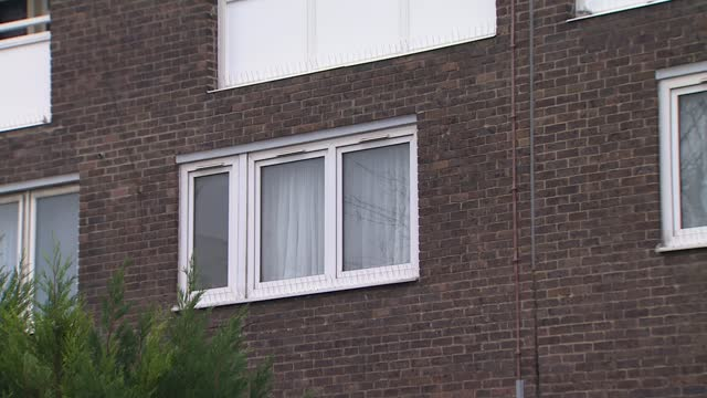 woman charged with murder of 4-year-old boy in plumstead; england: london: plumstead: ext gv low rise block of flats on invermore place - crime and murder stock videos & royalty-free footage