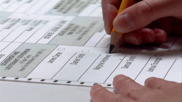 cu, zi, woman checking box next to name on ballot, ypsilanti, michigan, usa - voting ballot stock videos and b-roll footage