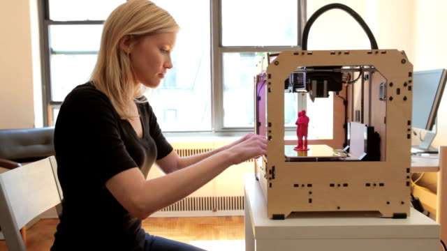 woman checking print on open source 3d printer - blonde hair stock videos & royalty-free footage