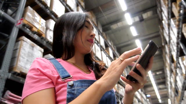 woman checking supplies in the warehouse - electronic organiser stock videos & royalty-free footage