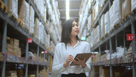 woman checking supplies in the warehouse,slow motion - electronic organizer stock videos & royalty-free footage