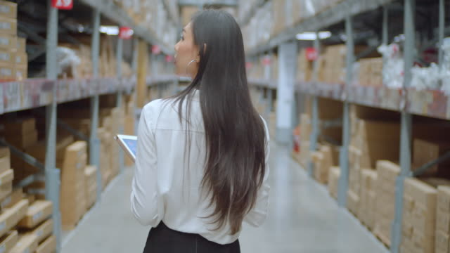 woman checking supplies in the warehouse,slow motion - electronic organiser stock videos & royalty-free footage