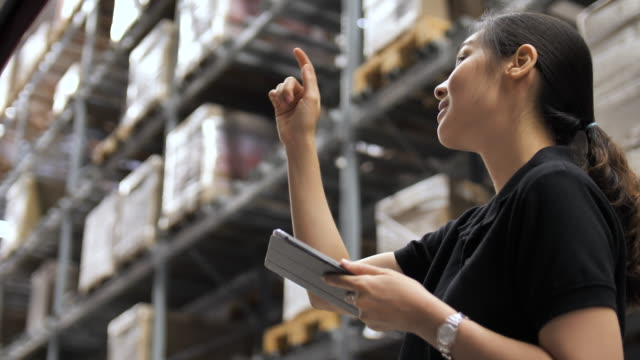 woman checklist in warehouse - quality control stock videos & royalty-free footage
