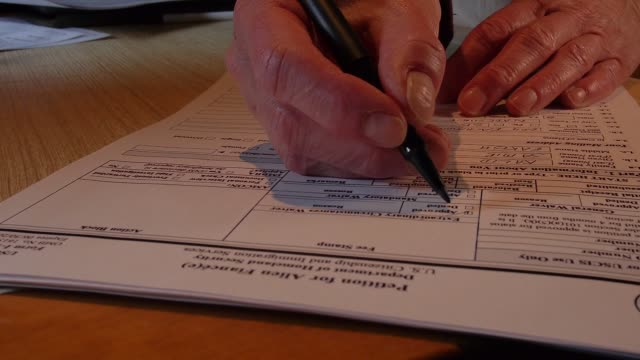 a woman checks the approval box on a mockup of a form used to petition the us government to allow a nonresident to enter the country as a fiancee of... - fiancé stock videos and b-roll footage